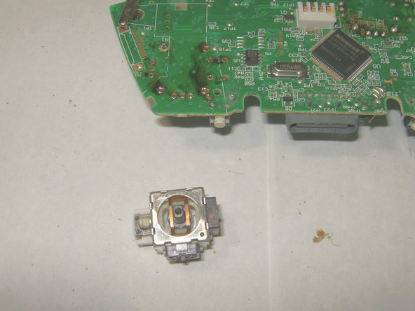 Image 2/3: Put the new 3D analog stick in place. Make sure that it is seated flush against the board.