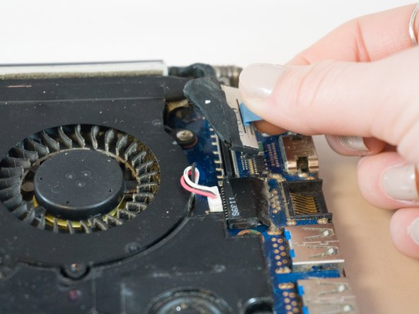 To reinstall the cable, hold it near the end and push it straight into the connector, being careful not to kink the cable.