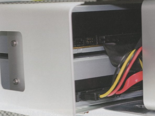 Set the optical drive assembly into the optical drive bay. There are two screws that line up onto a track in the bottom of the bay.