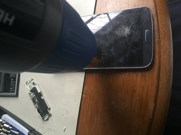 Using three guitar picks, insert them into the phone.  Be careful not to insert them at the bottom because the back button and menu button break easily, so take your time.