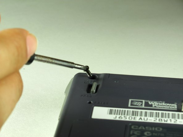 Using the Phillips #00 screwdriver, remove the two screws near the top of the device.