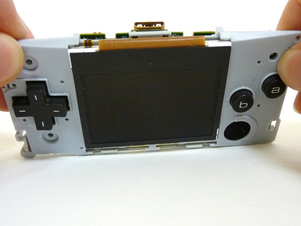 Without the front case, you will be left with the motherboard and the plastic mount. The LCD screen is attached to the motherboard by a ribbon and can fall off the plastic mount.