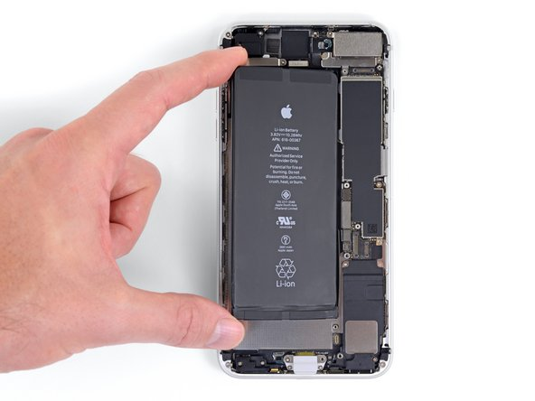 Carefully position the battery and set it into the iPhone.
