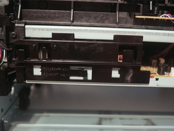 Remove the cable guide on the other side of the chassis.