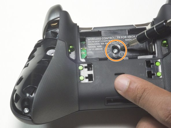 Four of the screws are located at the bottom tip of each grip and at the top of each grip, near the triggers of the controller.