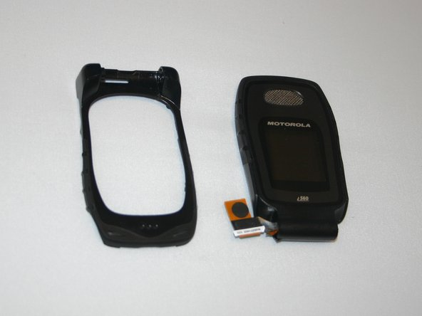 After sliding the ribbon cable through the front frame of the phone, the separated screen and phone frame will appear as shown.