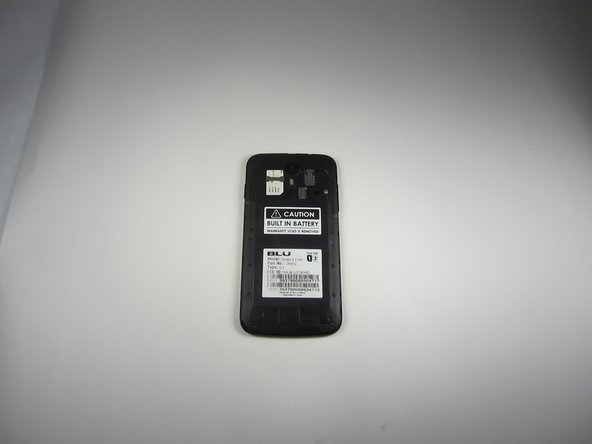 Take the front end tip of the SIM card (the side with the corner cut) and slide it gently into the SIM card slot.