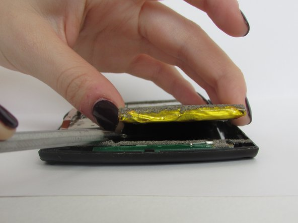 Be careful when prying the battery away from the device. Wiggle the plastic spudger under the battery if necessary to loosen the glue.