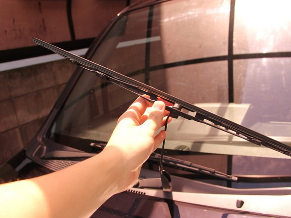 Return the windshield wiper blade back to its original direction.