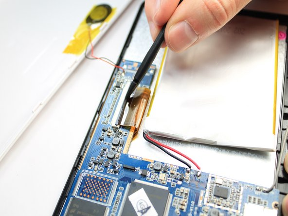 Image 2/3: Gently remove the ribbon cable from the socket using a tweezers.