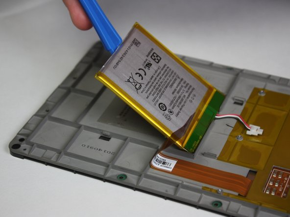 Use the plastic opening tool to pry the battery from the back side of the screen.