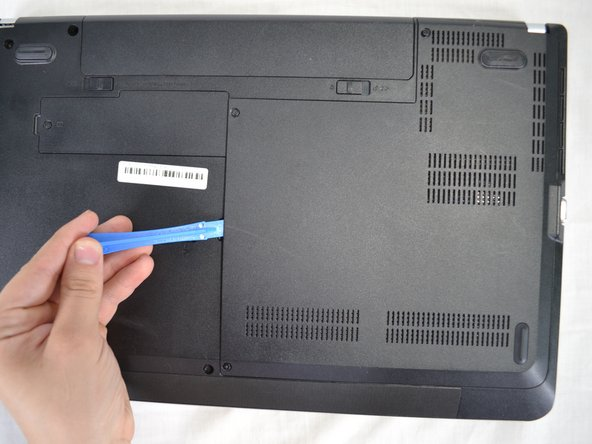 Once the screws have been removed, use plastic opening tool to pry off the back panel.