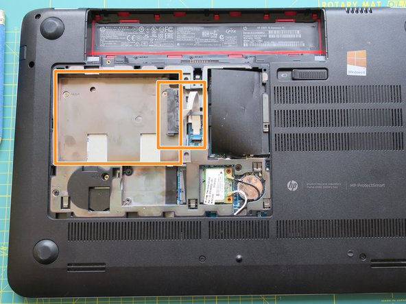 Remove the Hard Drive and the Little cable, connecting the HD to the Motherboard.
