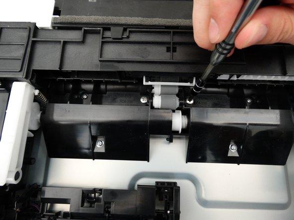 Remove one Phillips #2 8mm screw.