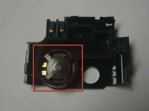 Image 1/1: The speaker should be placed back into its spot in the correct position. Take notice of the gold connectors
