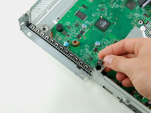 Lift the optical drive retaining bracket off the logic board.