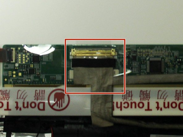 Carefully remove the tape on the display connector.