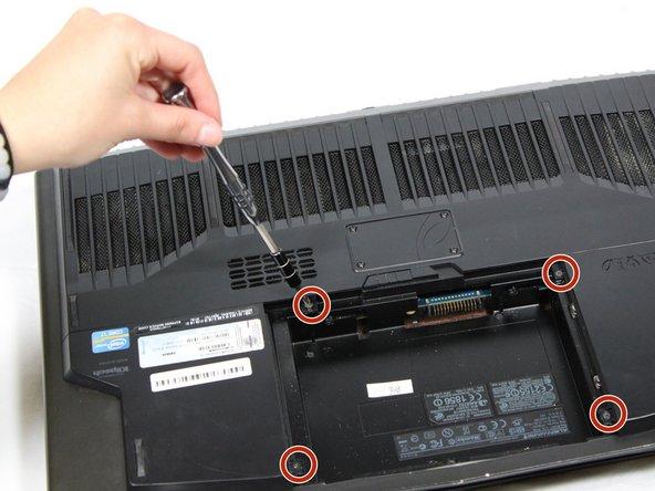 Unscrew four screws with a J000 screwdriver.
