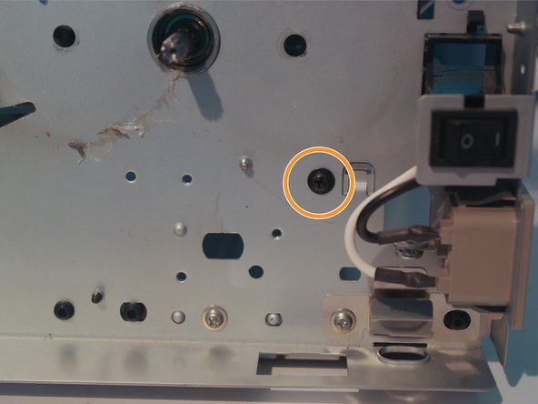 Image 2/3: Remove one screw on the printer chassis.