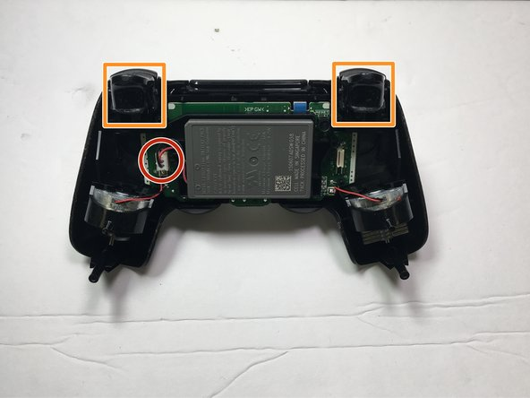Disconnect the connector that is connecting the battery to the motherboard. Remove the battery.