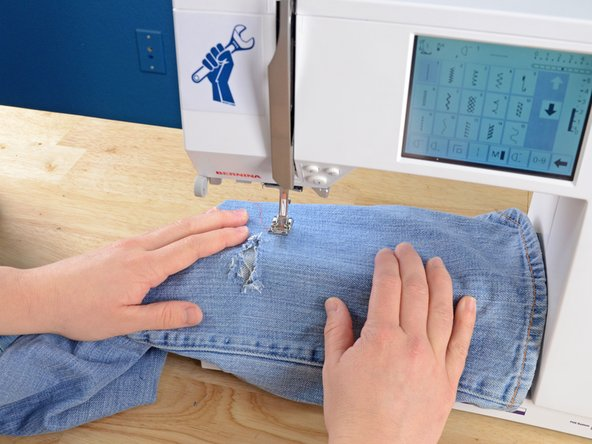 You may need to remove the sewing machine table for the pant leg to fit over the arm.