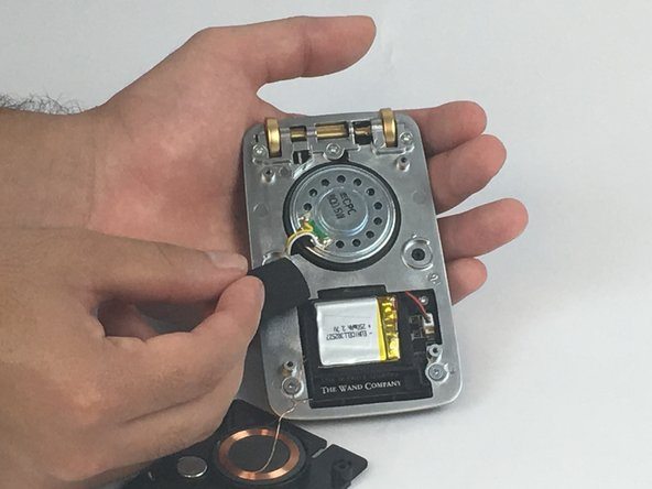 Remove the protective foam attached to the battery.