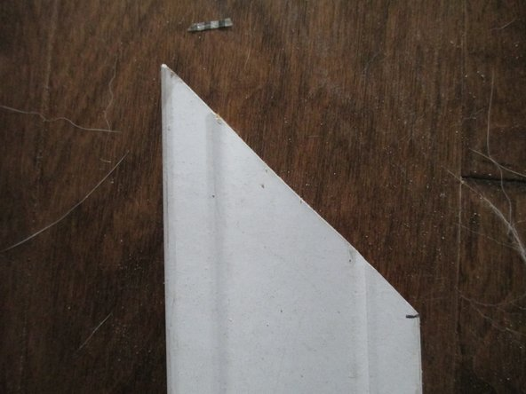 Align the trim on the saw so the mark you made is along the guide of the saw.