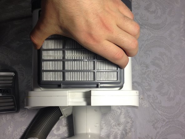 Lift the HEPA filter out of the vacuum