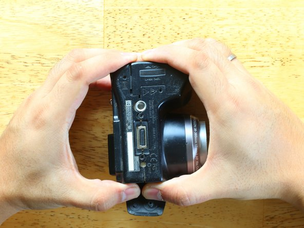 Continue to work carefully around all four edges of the camera. There are no more screws holding the body together and the body does not use breakable tabs.