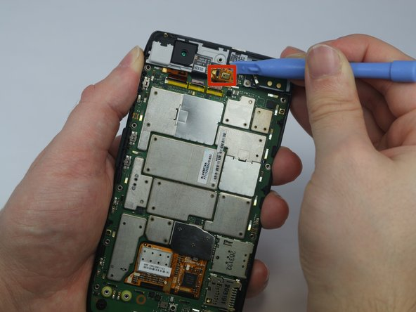 Image 1/3: Using the plastic opening tool gently lift the front-facing camera out of its resting place.