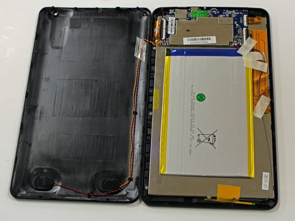 Carefully lift back panel away from the body of the device.
