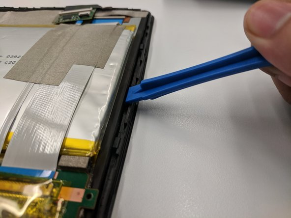 Safely separate the screen from the rest of the tablet's component by using the plastic opening tool.