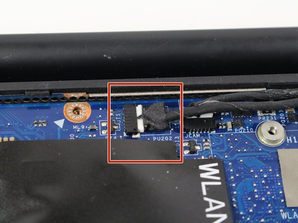 Use tweezers to gently detach the black and white cable connector out of its socket by pulling it to the right.