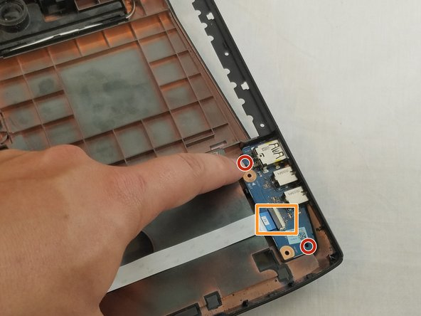 The pictures shown are taken with the motherboard removed. This is not required for the replacement of the USB module.