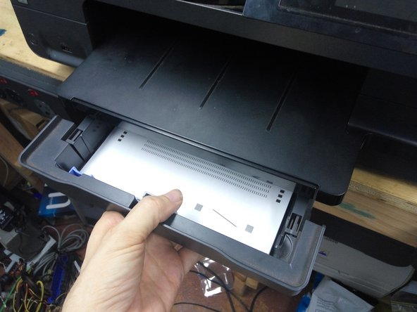 Remove the printer from the optional second paper tray.