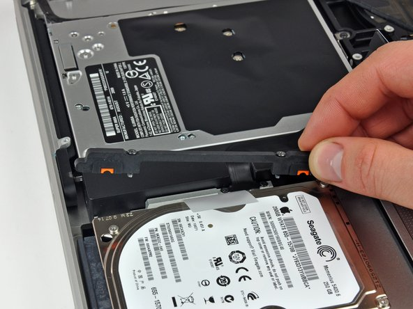 These screws are captive to the hard drive bracket.