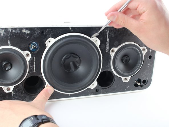 Pry out the large speaker with a metal spudger around the edge.