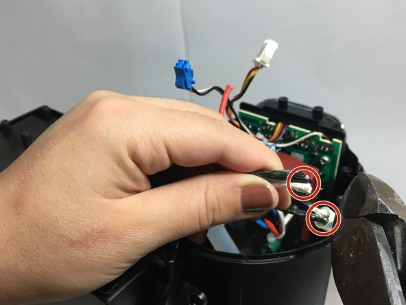 The power cord splits into two and feeds into two closed-end crimp connectors. Two wires from your coffee machine also enter these connectors.