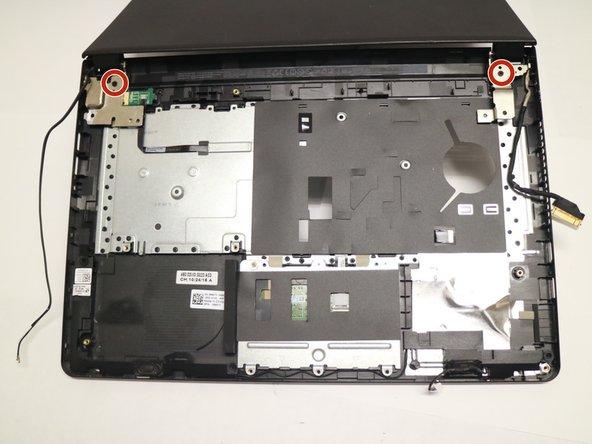 Turn laptop over to access the screen hinge screws.