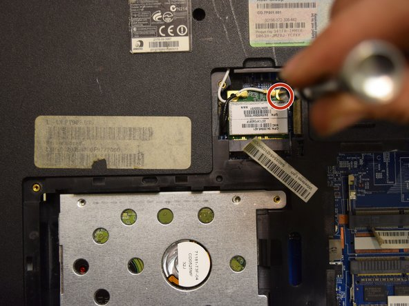 Unscrew the one phillips #0 4.0mm screw at the top of the card in order for it to be removed.