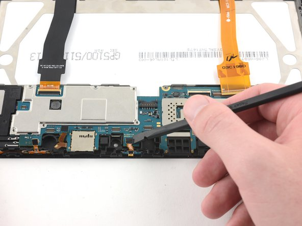 Use the flat end of the spudger to flip up the press-fit connector attaching the LED to the motherboard.