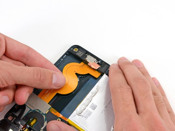 Gripping the large ribbon cable, gently pull the Lightning connector assembly out of the bottom of the case.