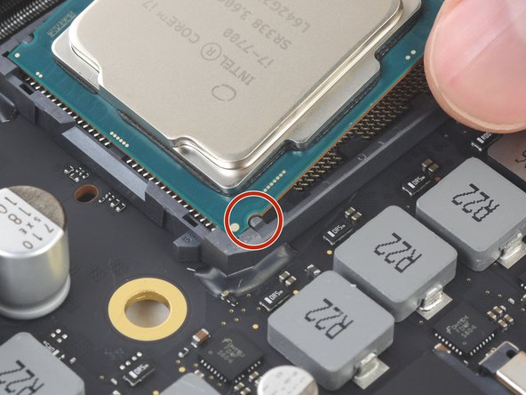 Small cutouts on the edges of the CPU align with notches on the sides of the socket.