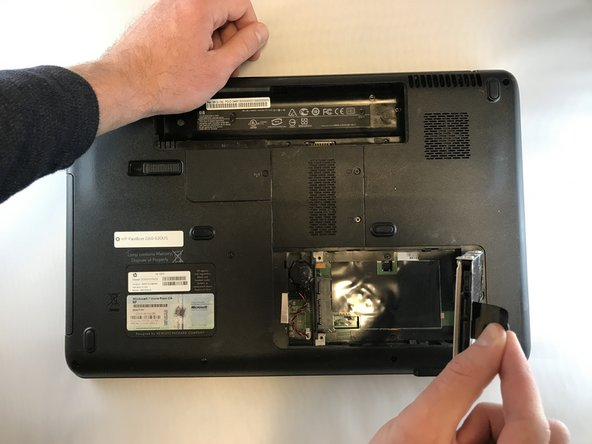 Lift up on black tap attached to the hard drive to remove the hard drive.
