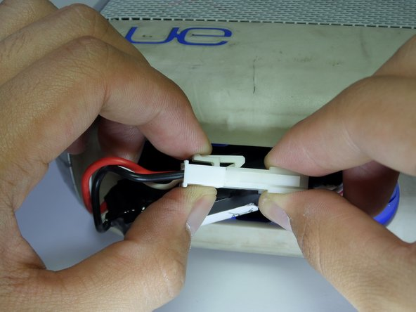 Firmly press down on the end of the latch and pull connector apart.