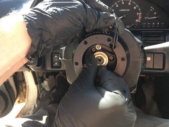 Reinstall the steering wheel retaining nut torqueing it down to 29 ft*lb using a torque wrench.