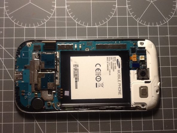 Use the spudger to gently pry the display data cable from the motherboard.