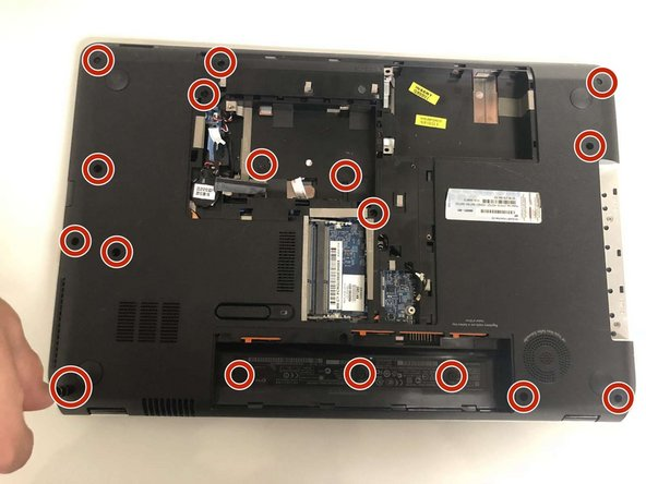 Remove the seventeen Phillips #00 screws securing the back panel to the laptop.