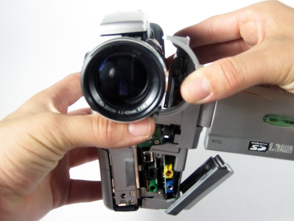 Image 1/1: Gently pull the side panel of the camera to the right to remove.