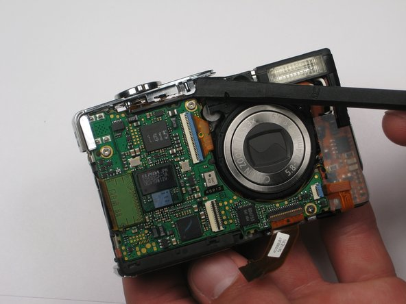 Remove the shutter panel with the spudger, now that the clip is released.